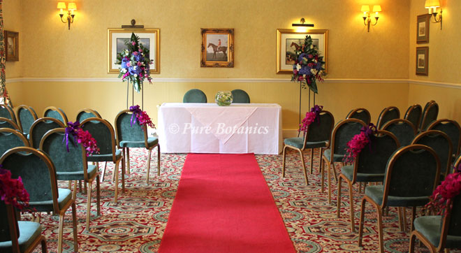 The rose room decorated with ceremony flowers for a wedding at Ansty Hall, West Midlands.