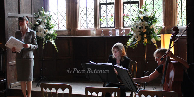 musicians infront of flower arrangements at a civil ceremony in warwickshire