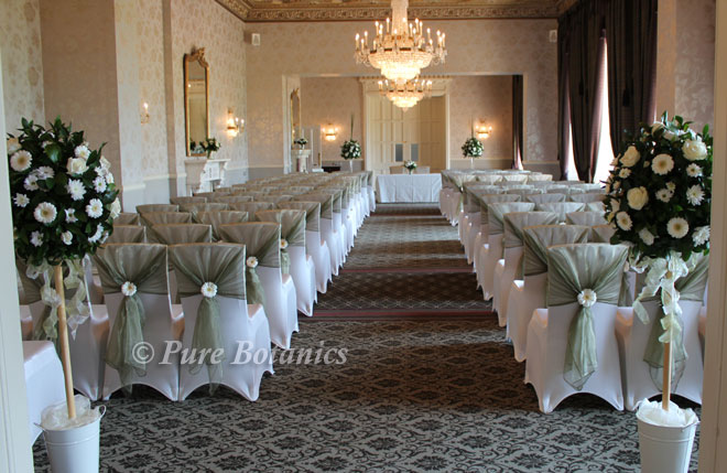 civil ceremony decorated with wedding flowers and chair covers