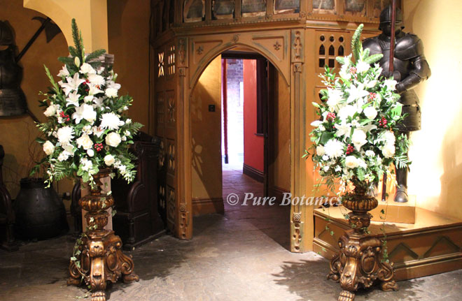 Pedestal arrangements for a civil ceremony wedding in the Abbey Gate at Coombe Abbey.