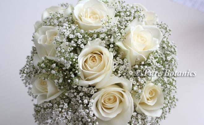 Bridal bouquet featuring ivory roses and gypsohila