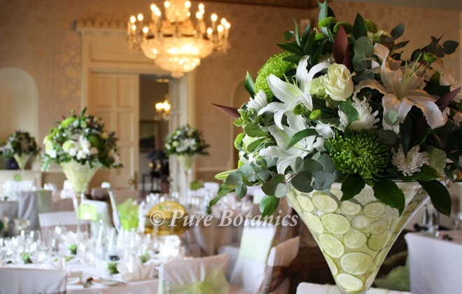 Lime green and ivory wedding centrepieces in martini vases
