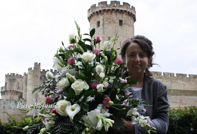 Delivering wedding flower arrangements to Warwick Castle.