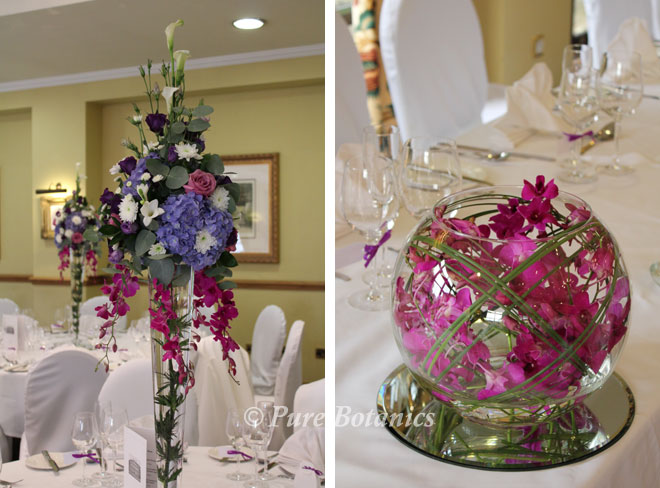 Purple and blue wedding table decorations featuring hydrangeas and orchids.
