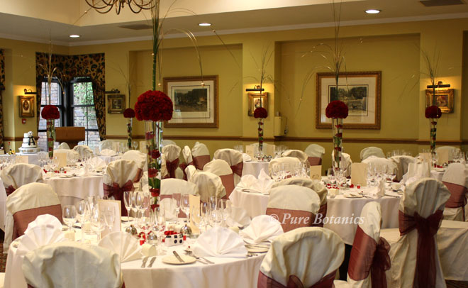 Red rose and carnation tall wedding centrepieces.