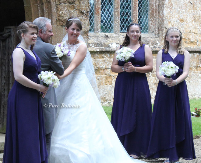 Summer posy bouquets in lilac and ivory for a summer wedding.