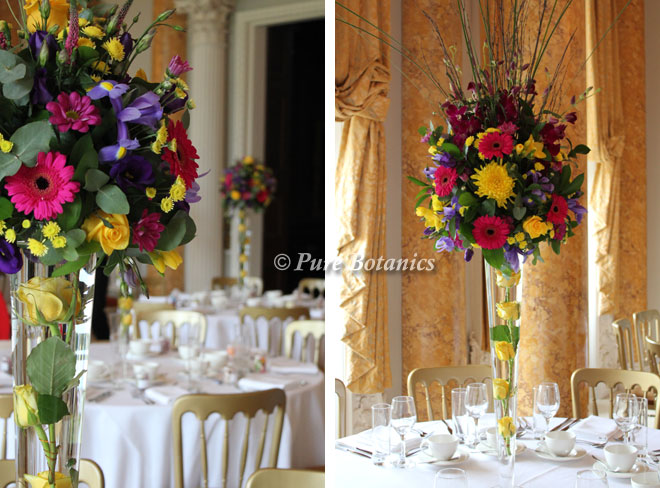 Exotic tall wedding centrepieces for a wedding at Stoneleigh Abbey.