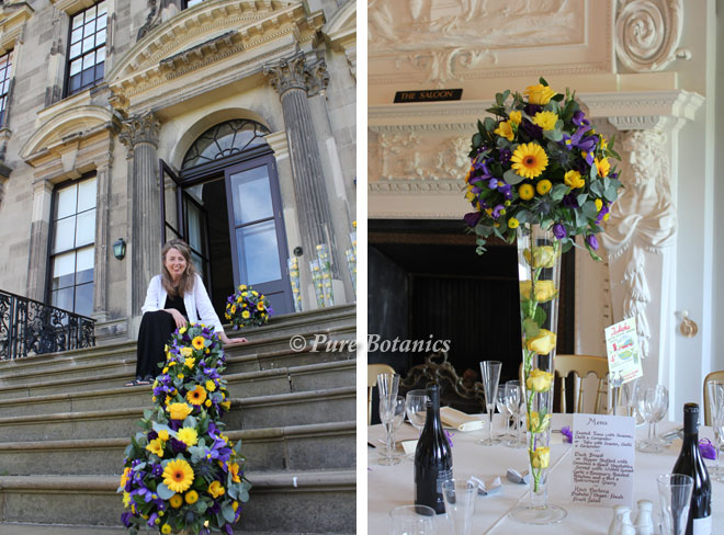 Purple and yellow tall wedding centrepieces in the Saloon at Stoneleigh Abbey.