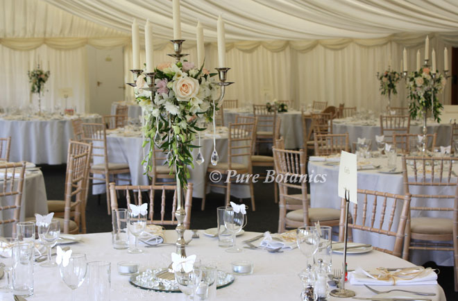 Candelabras decorated for a wedding breakfast at Wethele Mano, Leamington Spa.