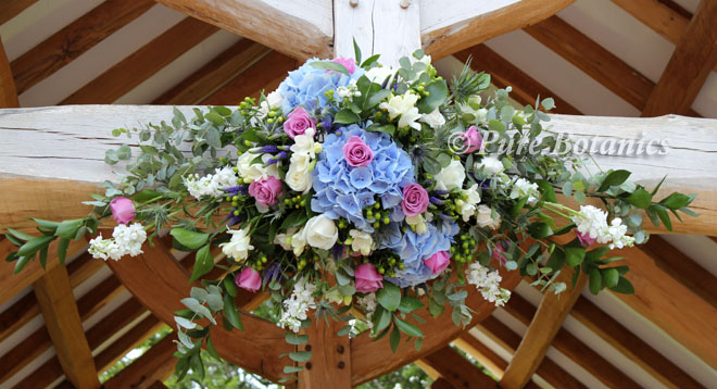 Outside wedding ceremony flowers at Wethele Manor