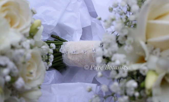 Lace covered wedding bouquet handle.