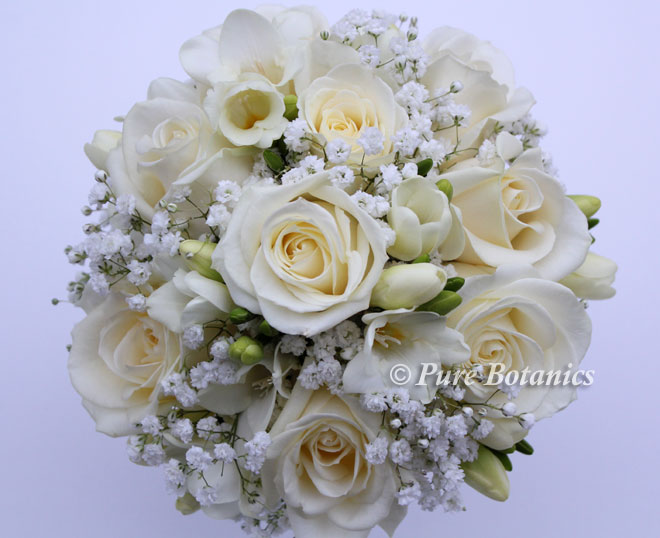 Romantic gypsophila rose and freesia handtied posy bouquet.