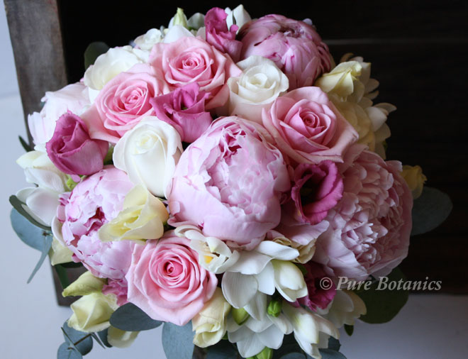 A spring wedding bouquet featuring pink peonies.