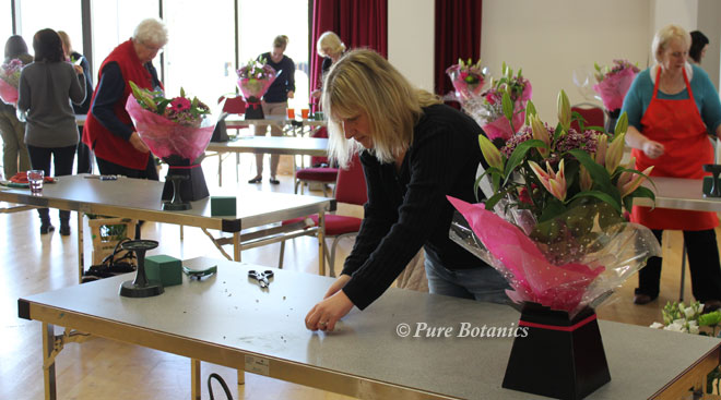 Students arranging flowers at the Pure Botanics masterclass.