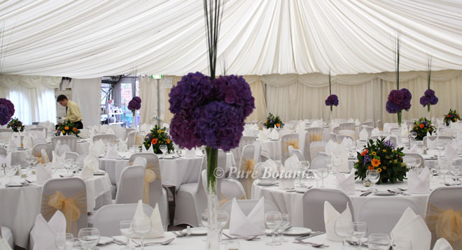 Purple hydrangea table decorations at Wroxall Abbey, Solihull.