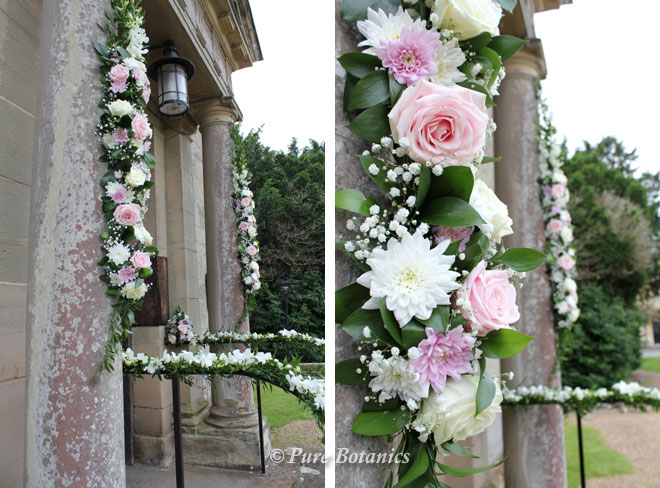 Adding rose flower garlands on the front of the church at Walton.