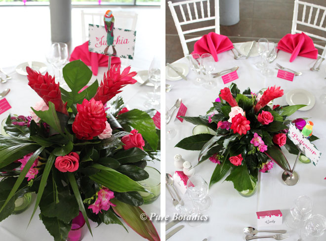 Tropical wedding flowers featuring roses, ginger and tropical leaves.