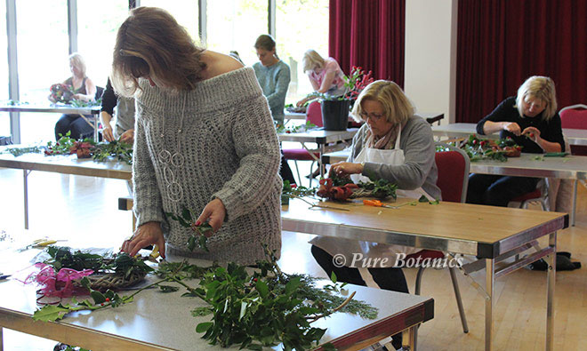 Students creating Christmas door wreaths at Warwick University.