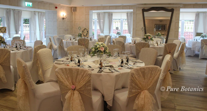 Vintage style wedding flower centrepieces at Nuthurst Grange, Solihull.