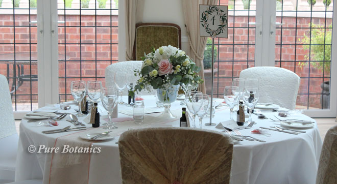 Low wedding centerpieces for a summer wedding at Nuthurst Grange.
