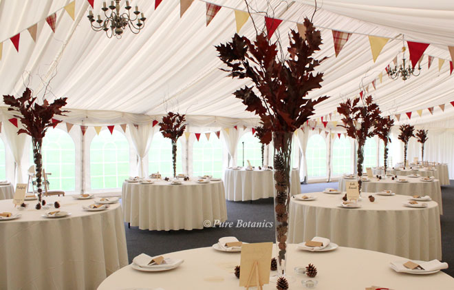 Tall red leaf and twig wedding centrepieces for a country wedding at Wethele Manor.