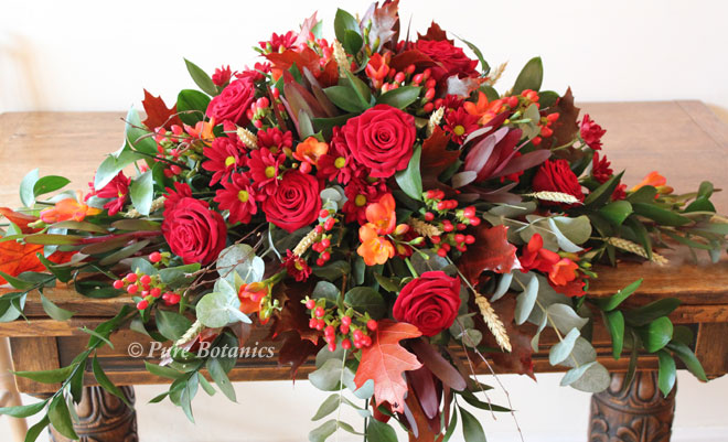 Natural top table arrangement for an Autumn time wedding.