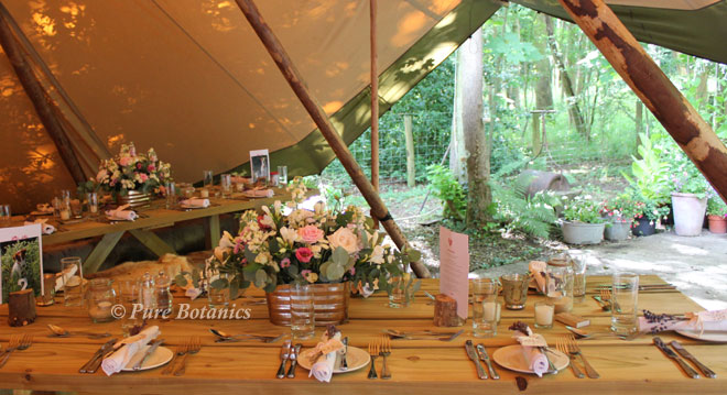 Natural wedding flower table decorations for a woodland wedding in Warwickshire.