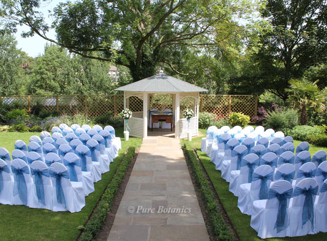 A wedding ceremony set up outdoors at Warwick House near Leamington Spa.