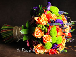 Autumn bridal bouquet featuring roses and lisianthus