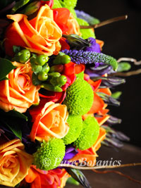 A close up of an autumn wedding bouquet featuring roses and freesias