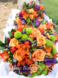 Bridal bouquets with an autumn wedding theme being delivered to the bride.