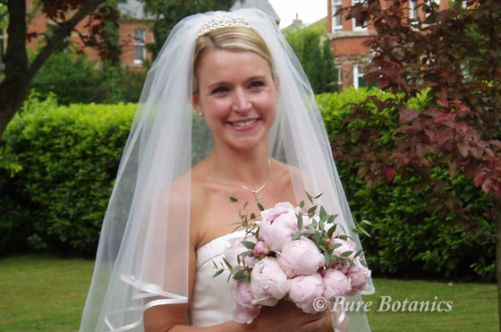 bridal bouquet created using pink peonies for a spring wedding