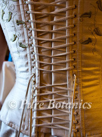 lace up detailing on back of a wedding dress
