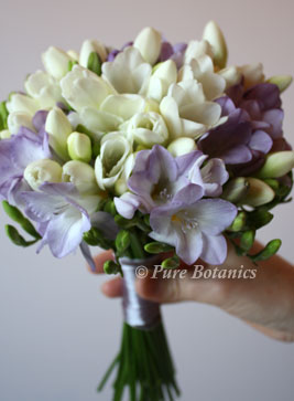 Lilac purple and ivory freesia bridesmaids bouquet, at Ansty Hall, Coventry