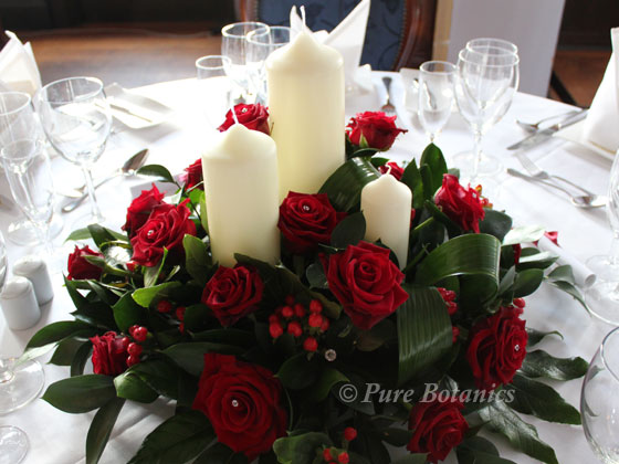 Low red rose wedding table centerpiece