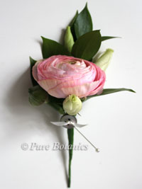 pink ranunculus buttonhole with pearl headed pin