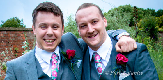 groom and best man with pink rose and thistle buttonholes