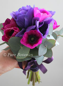 Purple and cerise anemones in flowergirl posy