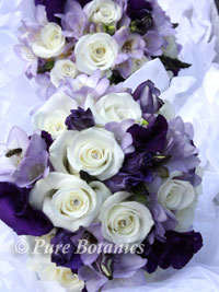 purple and ivory bridesmaids bouquets