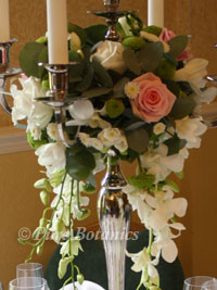 roses decorating a wedding candelabra