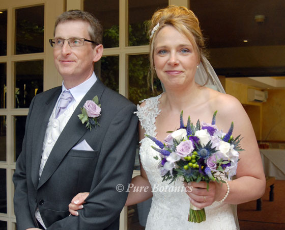 bride and father outside Nailcote Hall holding vintage handtied bridal bouquet