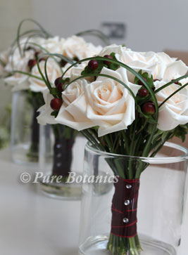 Cream vendella roses in bridesmaids bouquets