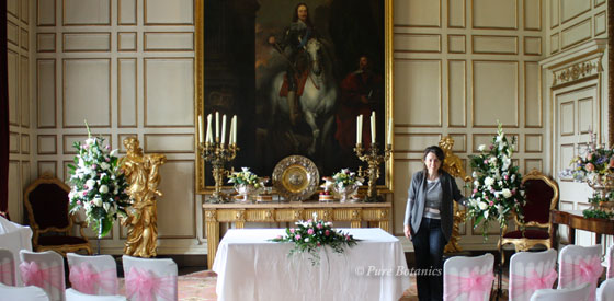 State Dining room laid out with wedding flowers as the ceremony room at Warwick Castle