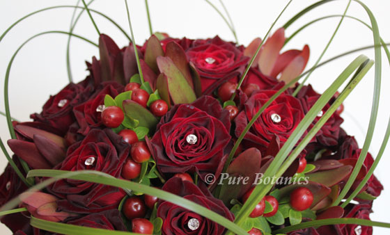 Black baccara roses in wedding bouquet