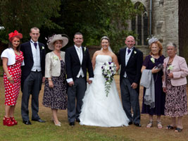 purple bridal bouquet at Wroxall Abbey