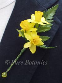minature daffodils in a wedding buttonhole