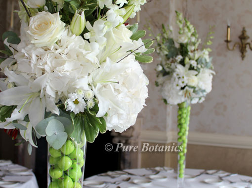 Green apple wedding theme pure botanics tall wedding centrepieces featuring green apples junglespirit Image collections