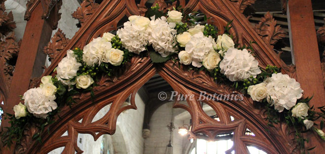 flowers over chapel arch for wedding