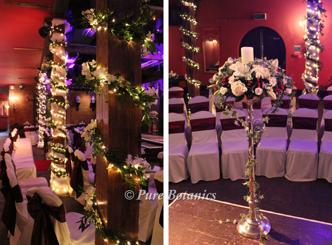 Wedding flowers arranged around candles and fairy lights for a winter wedding in Coventry.