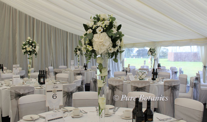 Tall hydrangea centrepieces for a Coventry marquee wedding.